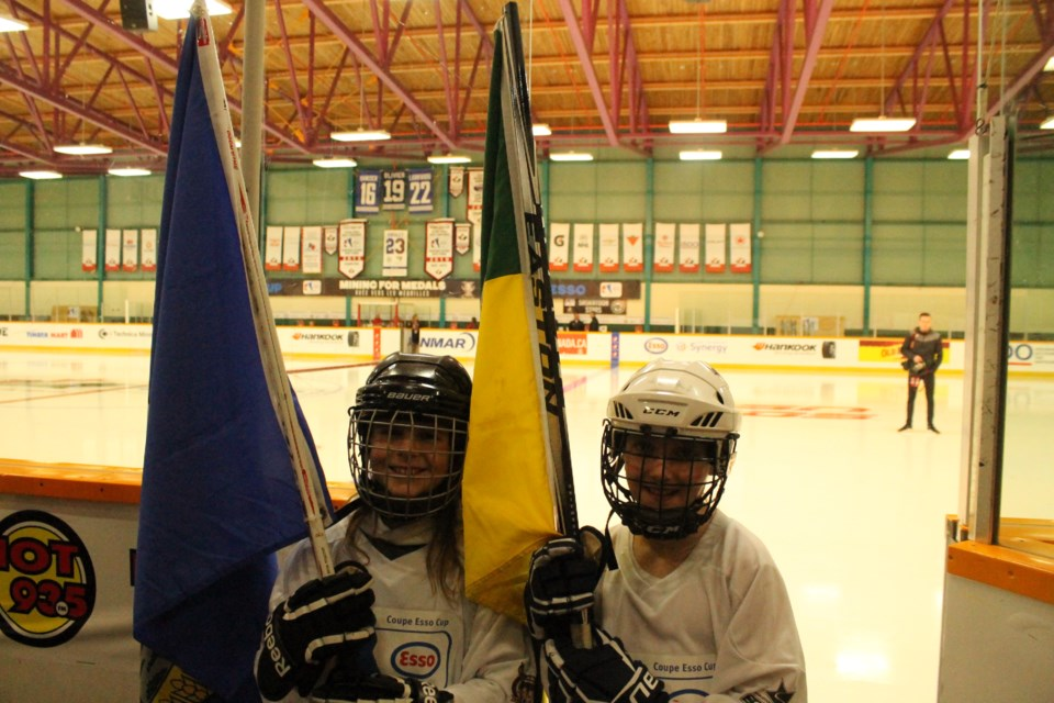 Olivia Hayes and Keira Brisco were the official flag bearers for Alberta and Saskatchewan on Tuesday afternoon. (Annie Duncan/Sudbury.com)