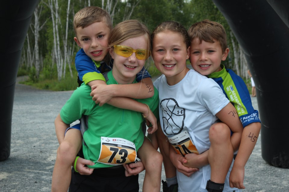 Colton (top left) and Mckenna Mende (bottom left), with Brody (top right) and Hailey Larochelle, at the first XTERRA: Conquer the Crater at Kivi Park. (Keira Ferguson/ Sudbury.com)