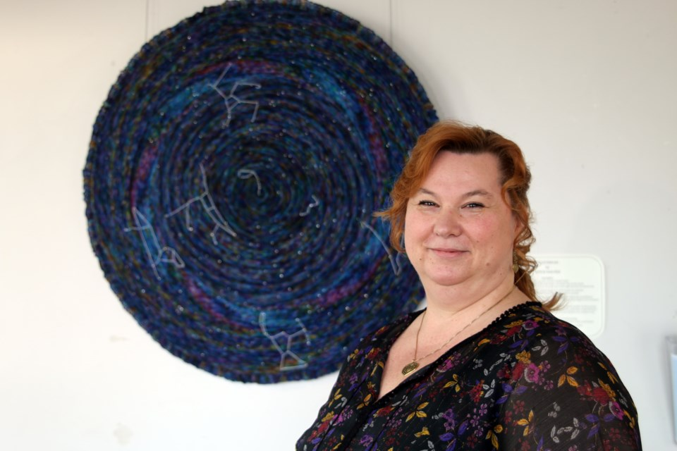 Heliina Swerdlyk and her feature piece, Celestarium, a recreation of the night sky on a circular shawl that includes all the constellations as viewed from the North Pole,
