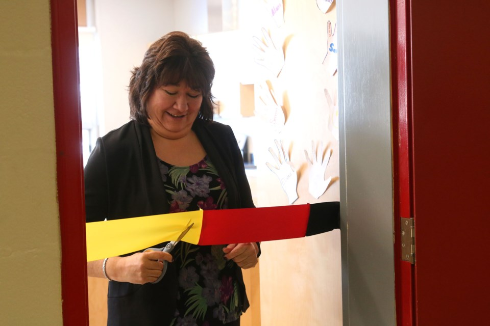 Norma Kejick, Northern Nishnawbe Education Council Executive Director, cuts the ribbon on one of three new classrooms at Dennis Franklin Cromarty High School that are part of the First Nations Trade School.