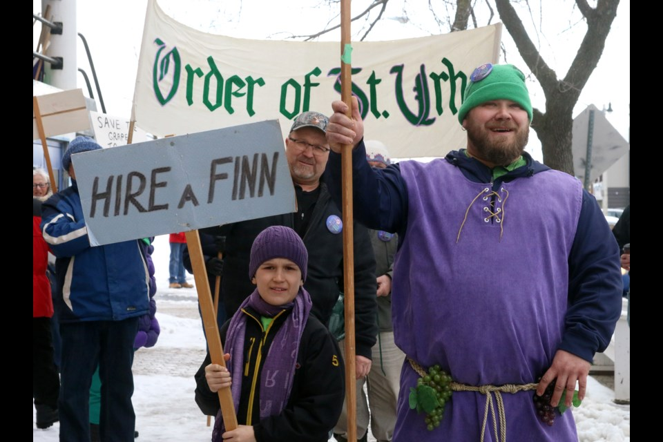Adam Nousiainen leads the St. Urho Day parade as the legendary Finnish Saint.