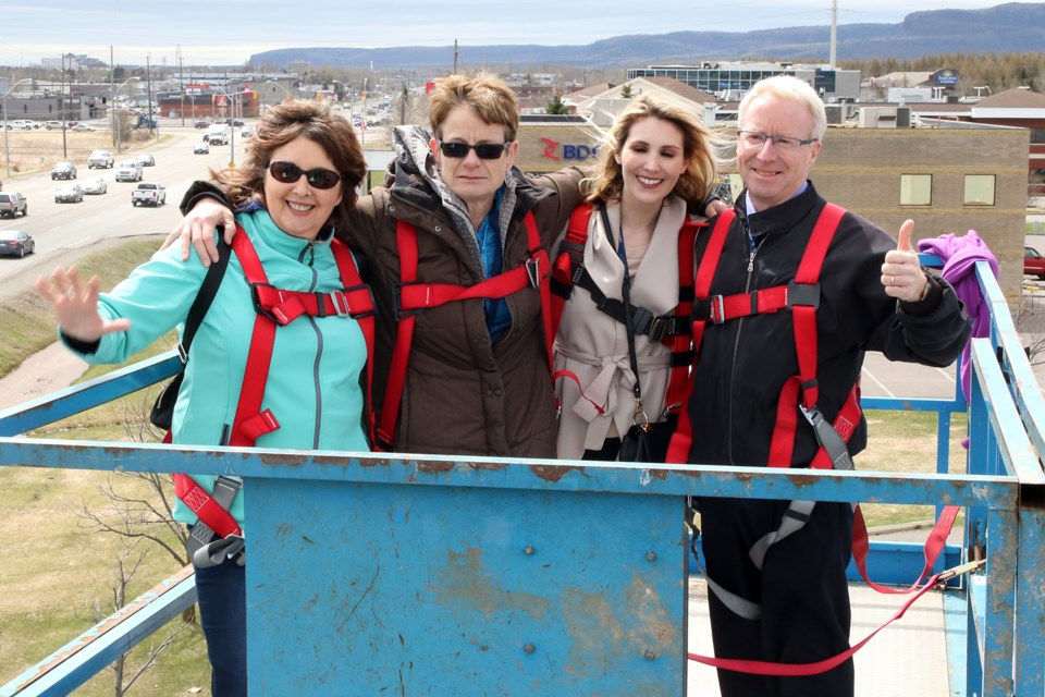 Staff at the Children's Centre Thunder Bay took part in the United Way's 25th annual Billboard Rescue on Thursday, May 18, 2017. From left: Norine Carroll, CEO Diane Walker, Vanessa Copetti and vice-president John Friday (Leith Dunick, tbnewswatch.com).
