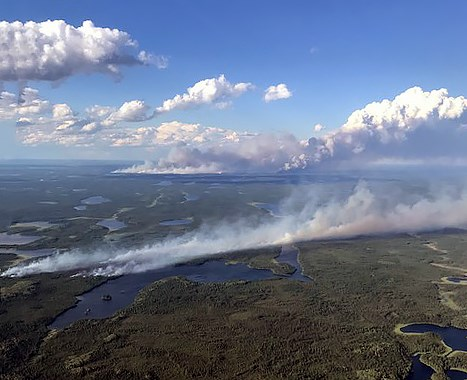 Two fires in the Summer Beaver area are visible here, one in the centre of the photo and the much larger one in the distance (courtesy MNRF)
