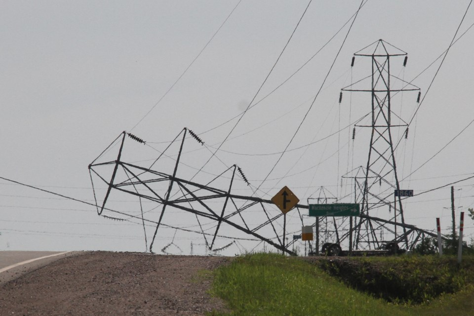 A pickup truck collided with a hydro tower on Lakeshore Drive on Tuesday, July 3, 2018. (Michael Charlebois / tbnewswatch)
