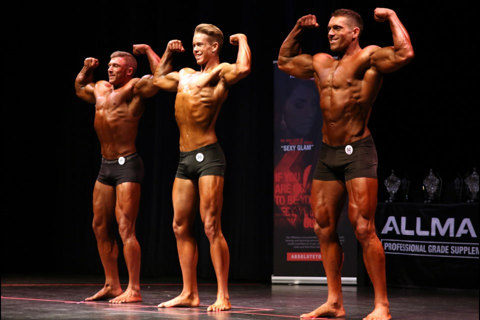 Bodybuilders flex their muscles in local competition