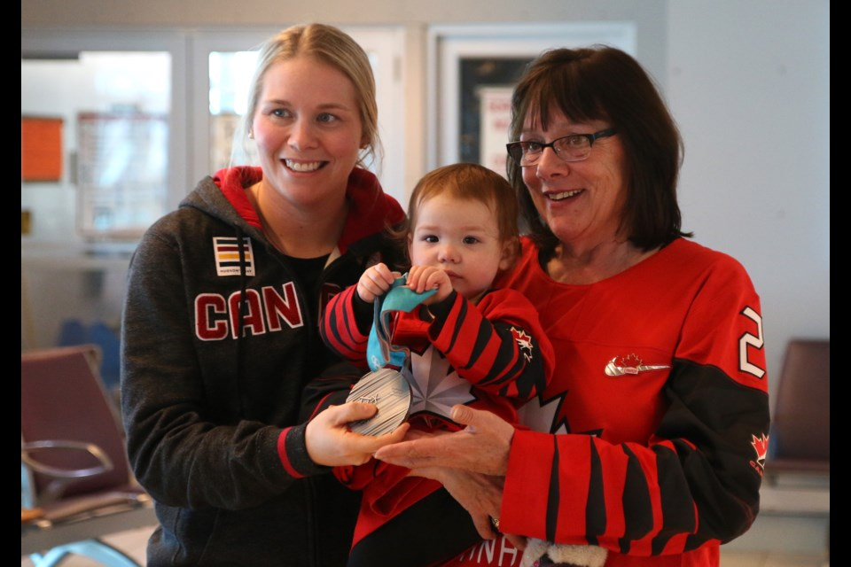 Haley Irwin (left) shares her Olympic silver medal with her mother, Kerry Irwin, and niece, Lillia.