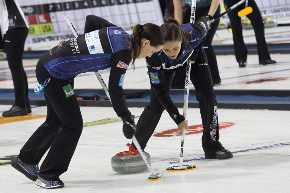 Team McCarville's Kendra Lilly and Sarah Potts sweep during their Pinty's Grand Slam of Curling Tour Challenge game against Team Walker at the Thunder Bay Tournament Centre on Tuesday, November 6, 2018. (Matt Vis, tbnewswatch.com)