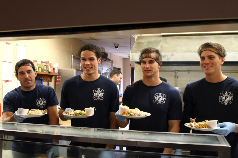From left to right: Harley Martin, Van Bailey, Justin Grochowski, and Kari Rikkonen serve up a Thanksgiving Day dinner at the Salvation Army on Sunday. (Photos by Doug Diaczuk - Tbnewswatch.com).