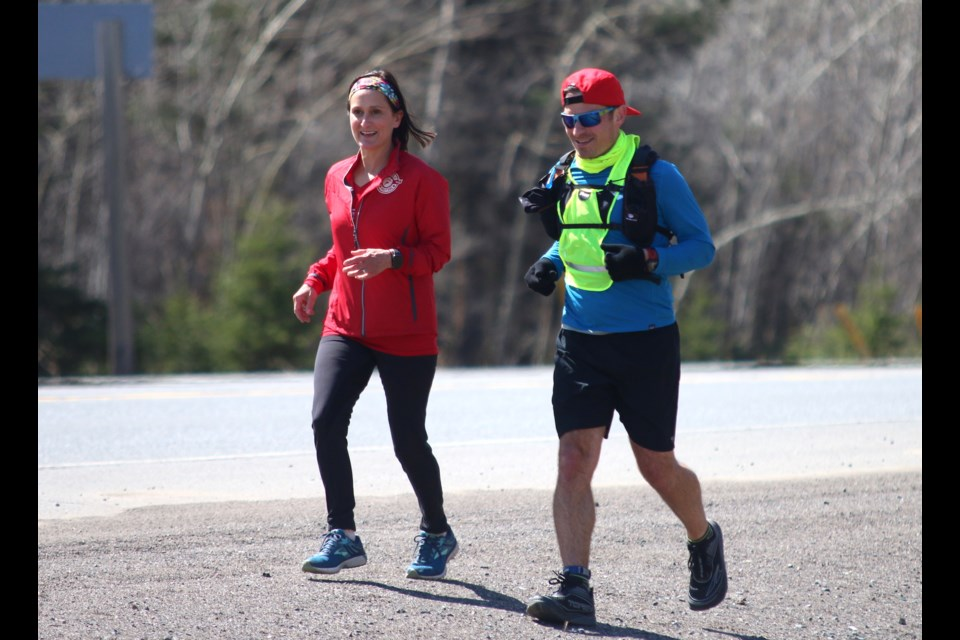 Antonio Stefanile ran 100 kilometres in support of youth running program, Thunder Bay Team Unbreakable. He was joined along the way by supporters, including runner Claudia Tropea. (Photo by Doug Diaczuk - Tbnewswatch.com).