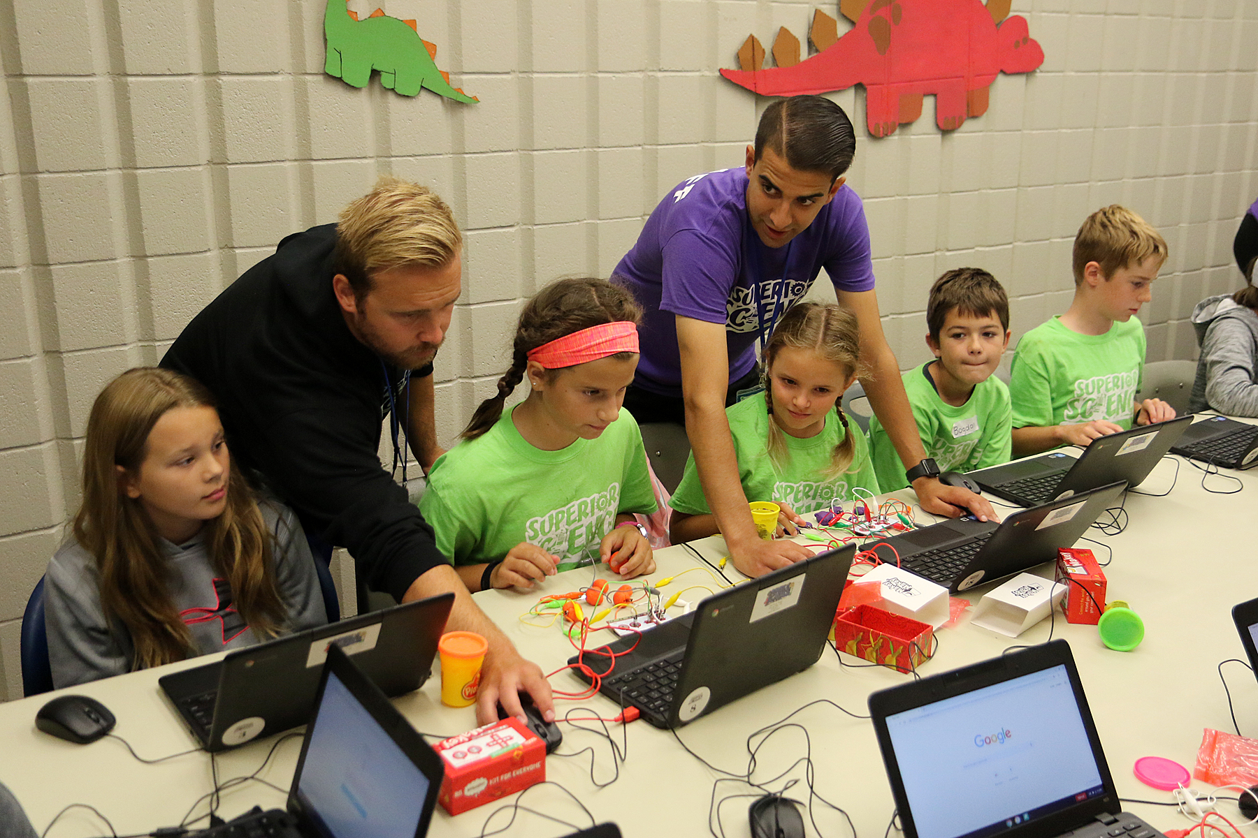 Students study science and coding at summer camp
