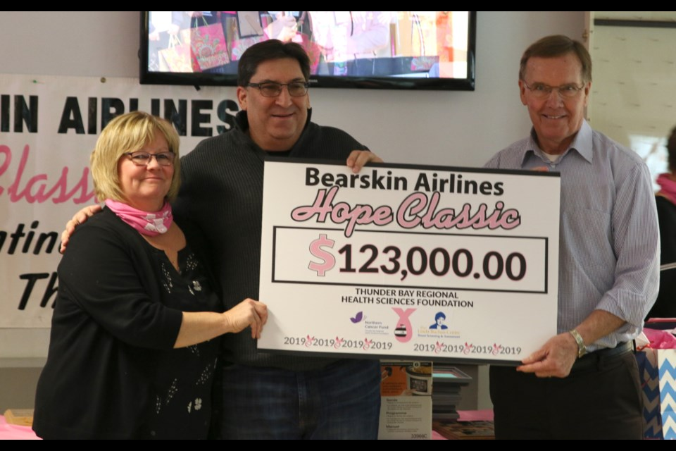 Susan Childs of the Bearskin Airlines Hope Classic (left), Ron Hell, director of marketing and Sales with Bearkskin Airlines (middle), and Brian McKinnon announce the total raised during the 23rd Annual Bearskin Airlines Hope Classic. (Photos by Doug Diaczuk - Tbnewswatch.com).