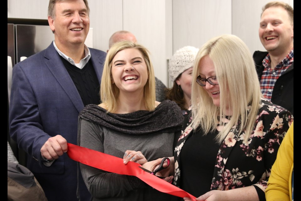 Krista Froome (middle) could not contain her excitement during the ribbon cutting to officially open Hope House at Adult and Teen Challenge. (Photos by Doug Diaczuk - Tbnewswatch.com).