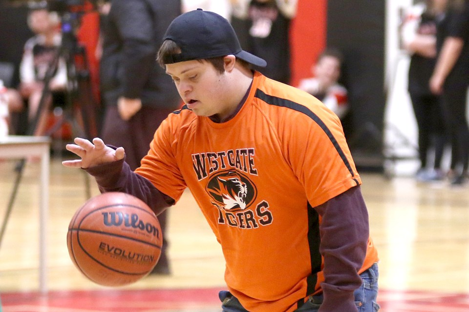 Westgate's Piper Hynnes takes part in the Special Olympics basketball qualifying tournament on Thursday, Feb. 21, 2019 at St. Ignatius High School. (Leith Dunick, tbnewswatch.com)