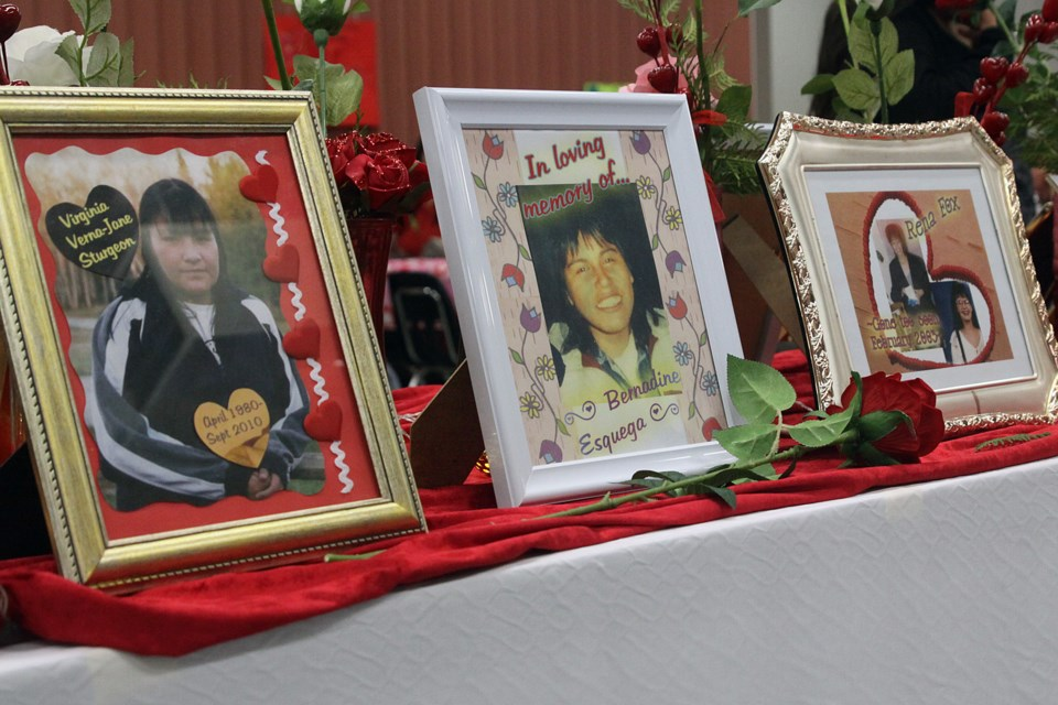 Photos of missing and murdered Indigenous women and girls are shown at the end of the Valentine's Day Memorial Walk. (Matt Vis, tbnewswatch.com)