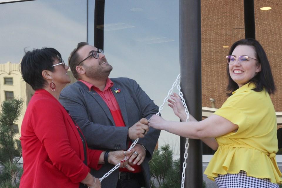 Shuniah mayor Wendy Landry, Thunder Pride Association chair Jason Veltri, and Coun. Shelby Ch'ng. (Michael Charlebois, tbnewswatch)