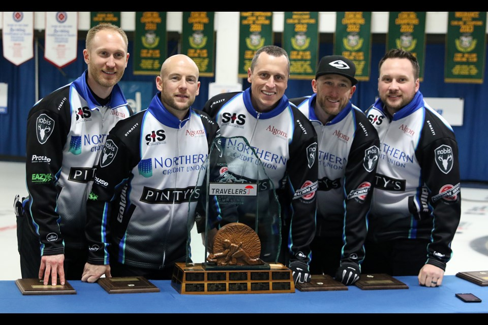 Brad Jacobs (from left), Ryan Fry, E.J. Harnden, Ryan Harnden and coach Caleb Flaxey celebrate their win on Sunday, Feb. 12, 2017 at the 2017 Travelers Provincial Men's Championship (Leith Dunick, tbnewswatch.com).