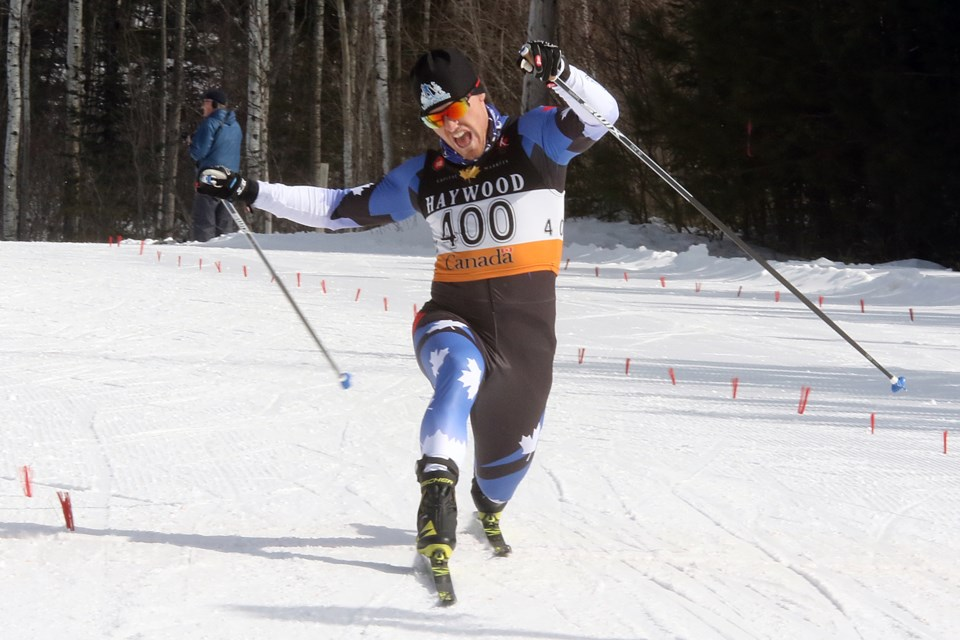 Thunder Bay's Michael Somppi lunges at the line to take second place in the senior men's 15-kilometre pursuit race at Lappe Nordic Ski Centre on Tuesday, March 13, 2018. (Leith Dunick, tbnewswatch.com)