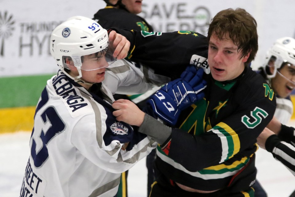 Dryden's Jacob Siebenga (left) and Thunder Bay's Cole Turbide tangle during an SIJHL contest at Fort William Gardens on Saturdy, Feb. 9, 2019. (Leith Dunick, tbnewswatch.com)