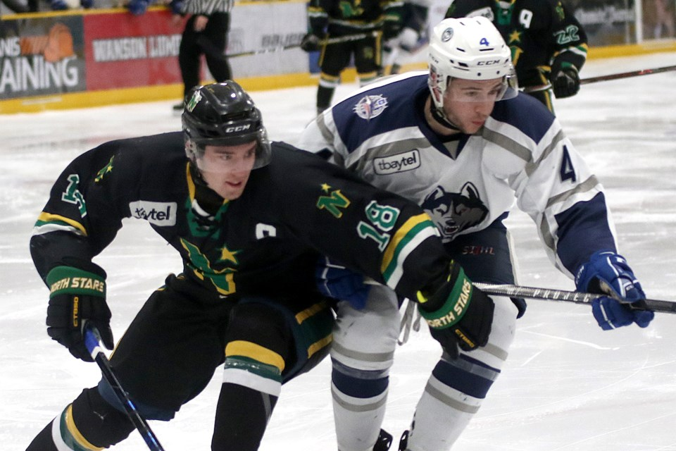 North Stars captain Ryan Mignault (left) scored a pair of goals on Tuesday, March 5, 2019 against Kyle Sargent and the Dryden Ice Dogs at Fort William Gardens (Leith Dunick, tbnewswatch.com)