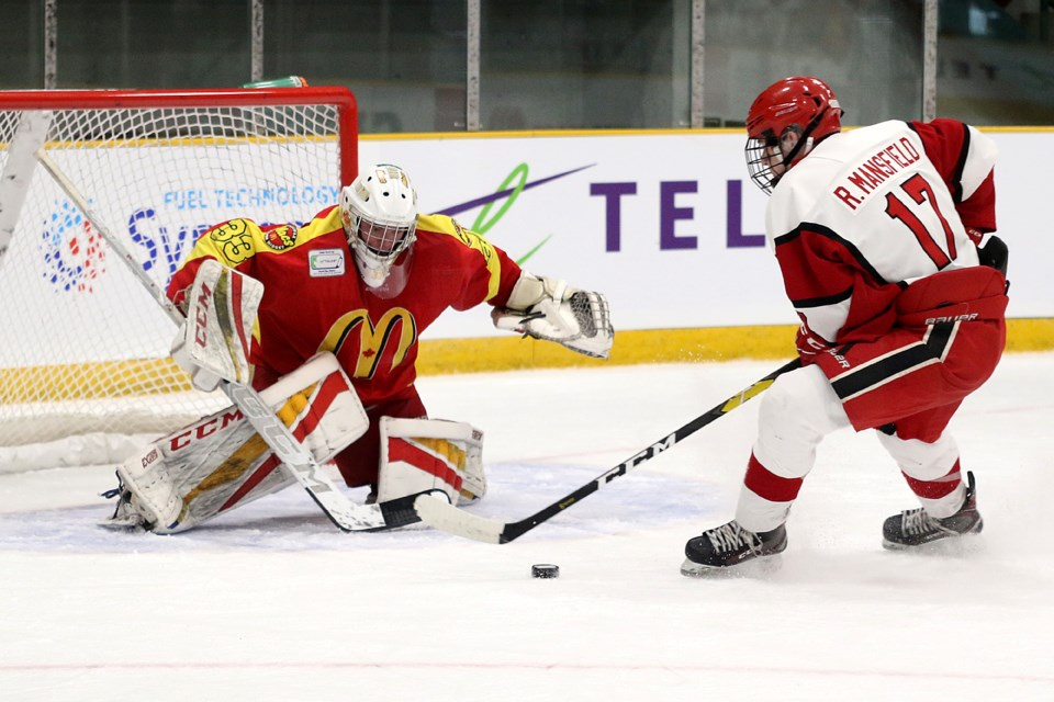 Toronto's Ryan Mansfield is stopped on a first-period breakaway by Halifax Macs goalie Liam Oxner at the Telus Cup on Monday, April 22, 2019 at Fort William Gardens. (Leith Dunick, tbnewswatch.com)