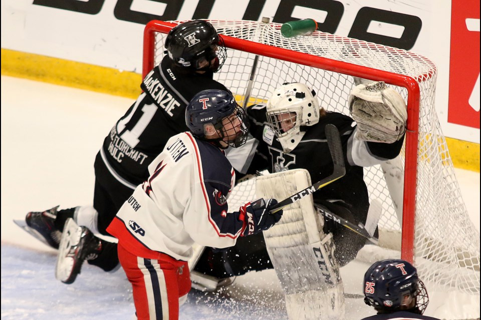 Thunder Bay Kings goalie Eric Vanska is bowled into the net, teammate Cole MacKenie and Tisdale's Liam Rutten jockey for position on Tuesday, April 23, 2019. (Leith Dunick, tbnewswatch.com)