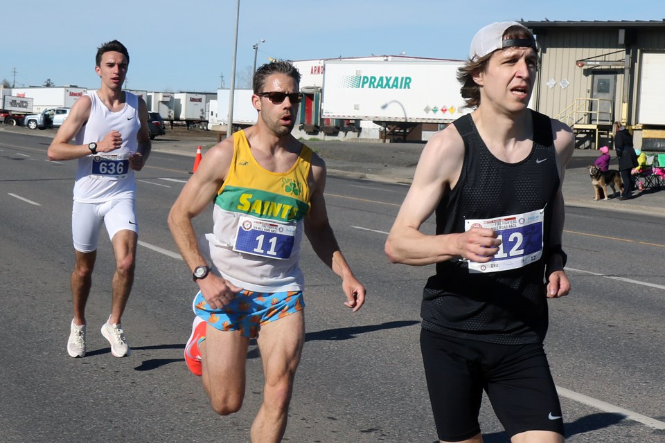 Winner Scott Behling (right) sets the pace on Monday, May 20, 2019 during the Fireghters Ten Mile Road race, with runner-up finisher Trevor Ziamk and third-place finisher Jordan McIntosh. (Leith Dunick, tbnewswatch.com)