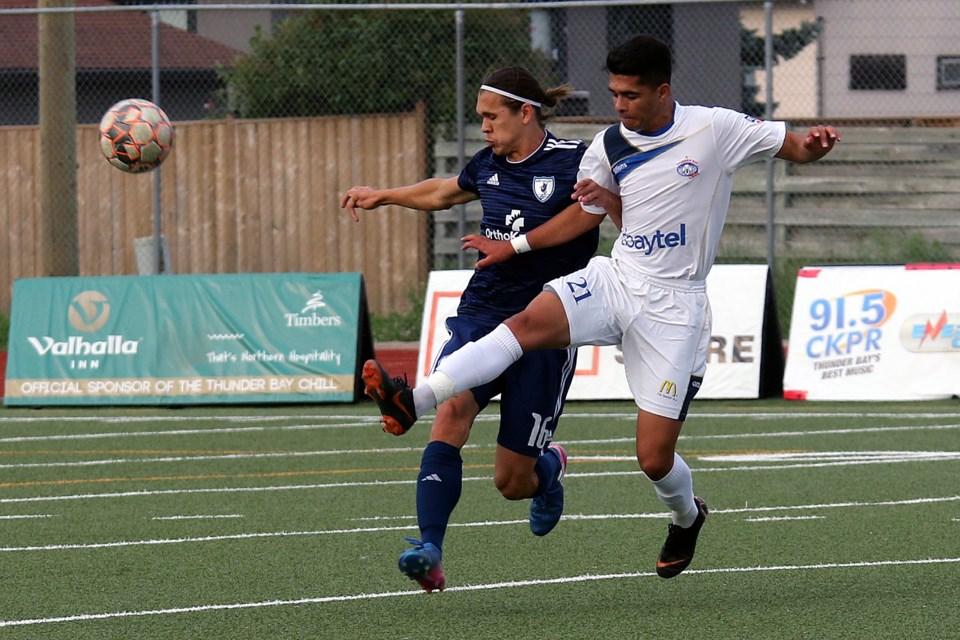 The Chill's Ammed Mohammed (right) battles Kaw Valley's Daniel Kozma on Wednesday, July 11, 2018 at Fort William Stadium. (Leith Dunick, tbnewswatch.com)