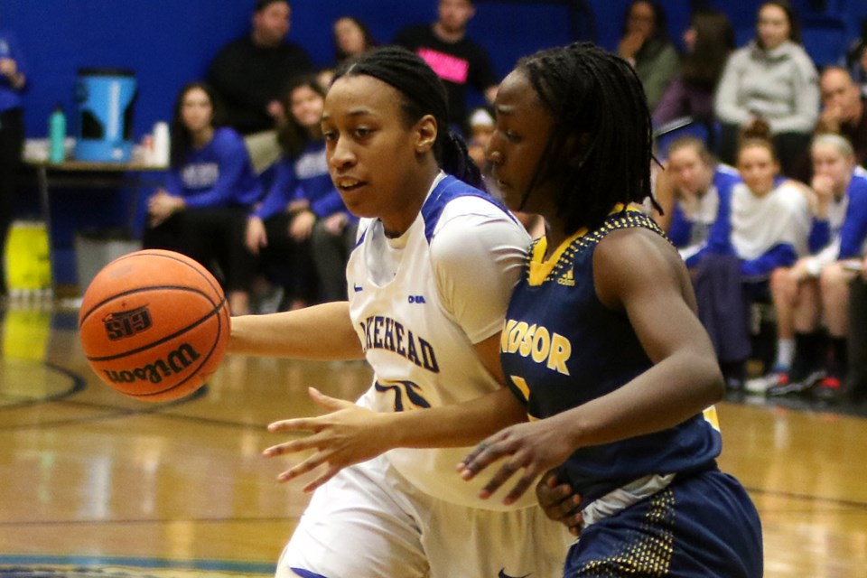 Lakehead's Tianna Warwick-Dawkins and Windsor's Eve Osamusali on Friday, Jan. 11, 2019 at the C.J. Sanders Fieldhouse. (Leith Dunick, tbnewswatch.com)