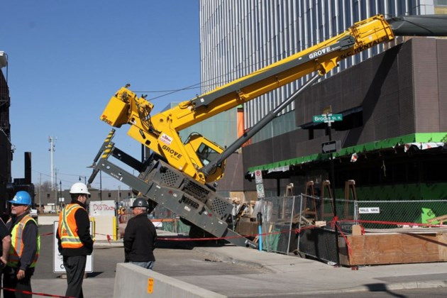 crane tips over at construction site of consolidated courthouse