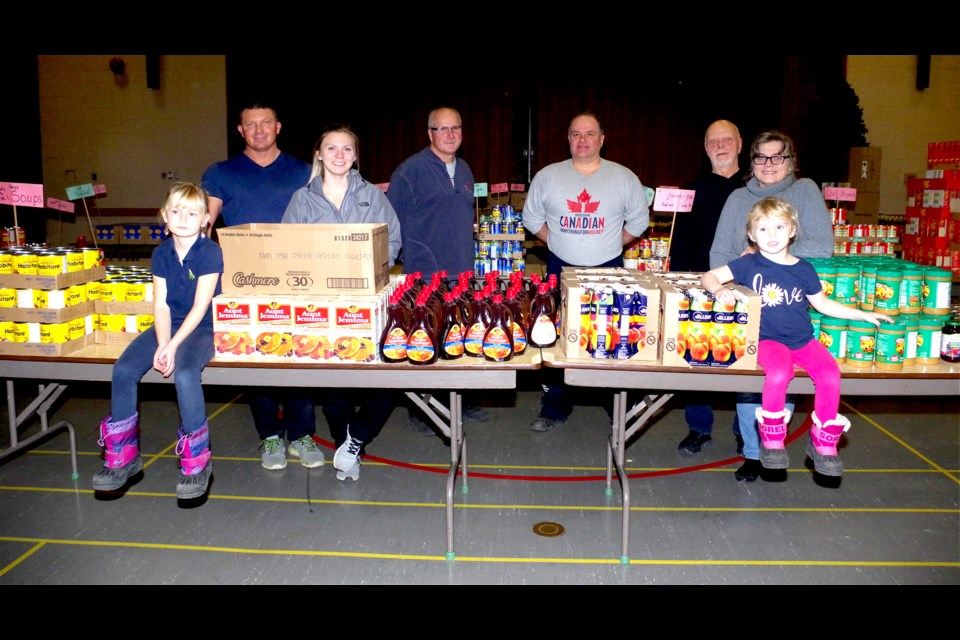 On hand to sort the food were: Rhonda Kenny and boyfriend Pat Todd, daughter Aime and son-in-law Scott