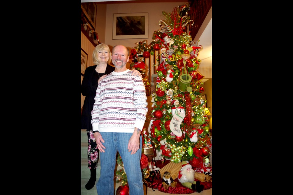 Claudia and Mike Niles greeted their guests in their foyer beside the first of eight Christmas trees decorated in their home A ninth stand on the front porch. Bob Liddycoat/ThoroldNews