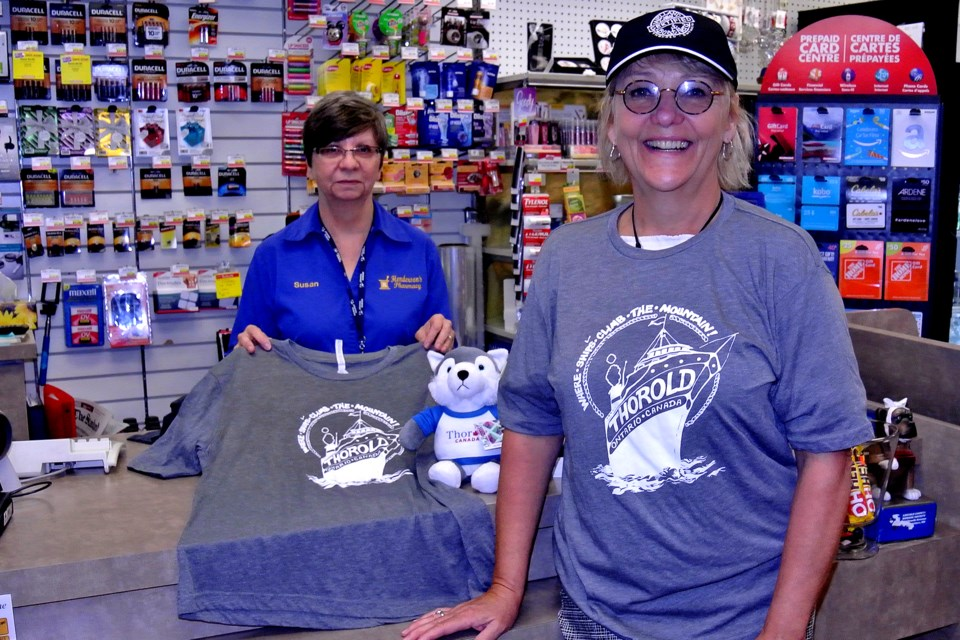 Susan Horn, left, and Thorold tourism agent Sue Morin display the new Thorold T-shirts and caps now on sale at Henderson's Pharmacy. Bob Liddycoat / Thorold News