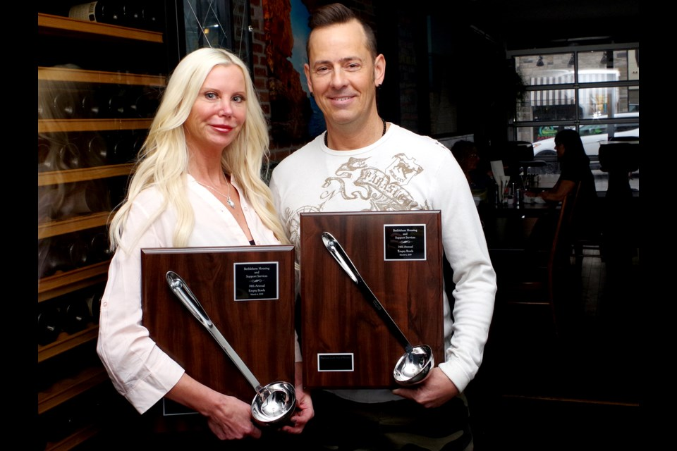 Shannon Lindsay and William Brunyansky with most recent 'Empty Bowls' awards. Bob Liddycoat / Thorold News