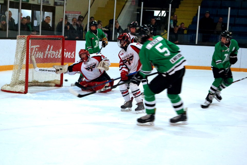 Quinton Pierce (5) finds a wide open net to score the winning goal for Napanee. Bob Liddycoat / Thorold News