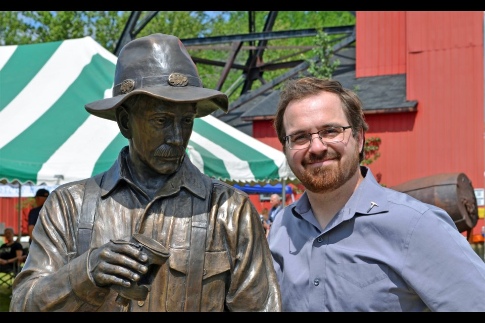 Sculptor Tyler Fauvelle with the Kirkland Lake Centennial Prospector monument. (Supplied photo)