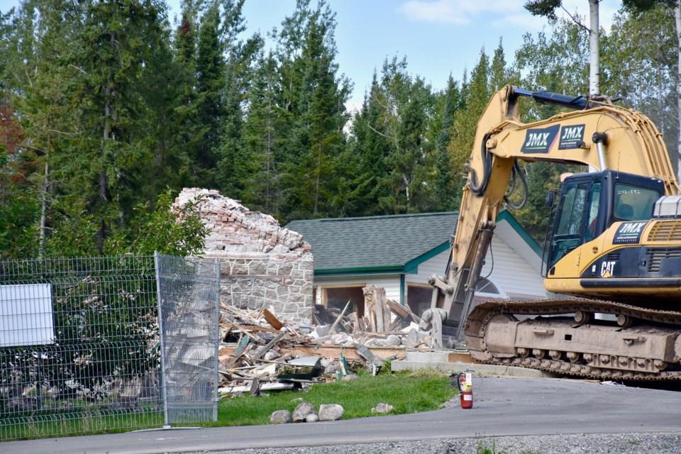 Crews demolish the historic mine manager's house on Gold Mine Road. Maija Hoggett/TimminsToday