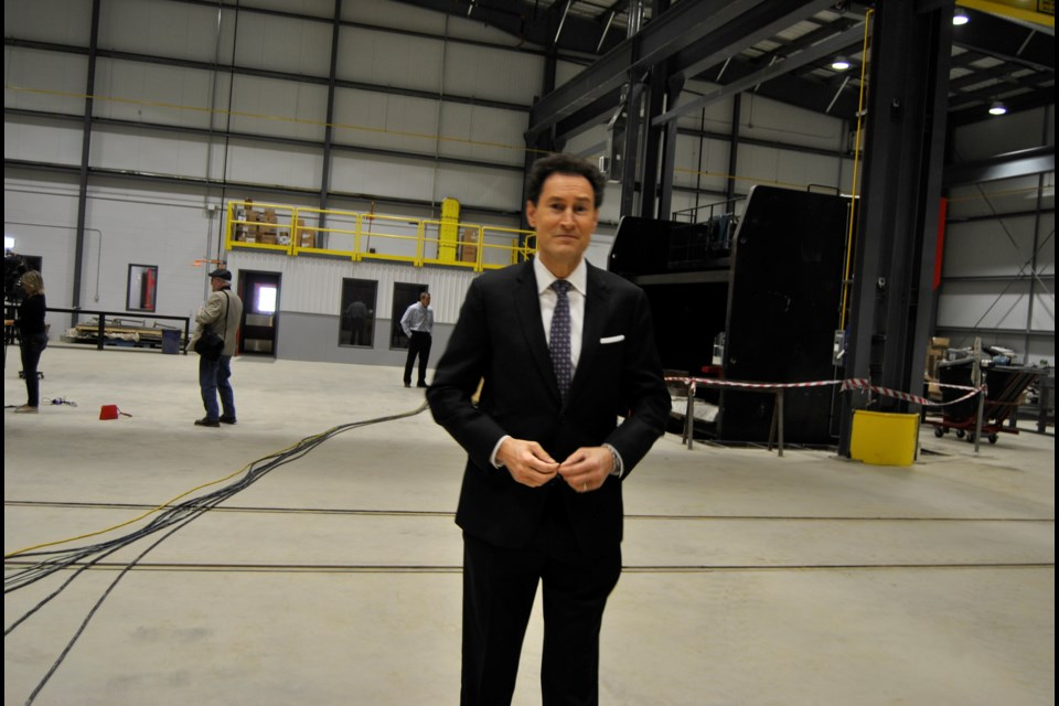 "Steve Paikin, host of TVO's ""The Agenda"" standing in the midst of the cavernous The Bucket Shop facility that served as the backdrop for a discussion on Timmins and region's economy. Frank Giorno for TimminsToday."