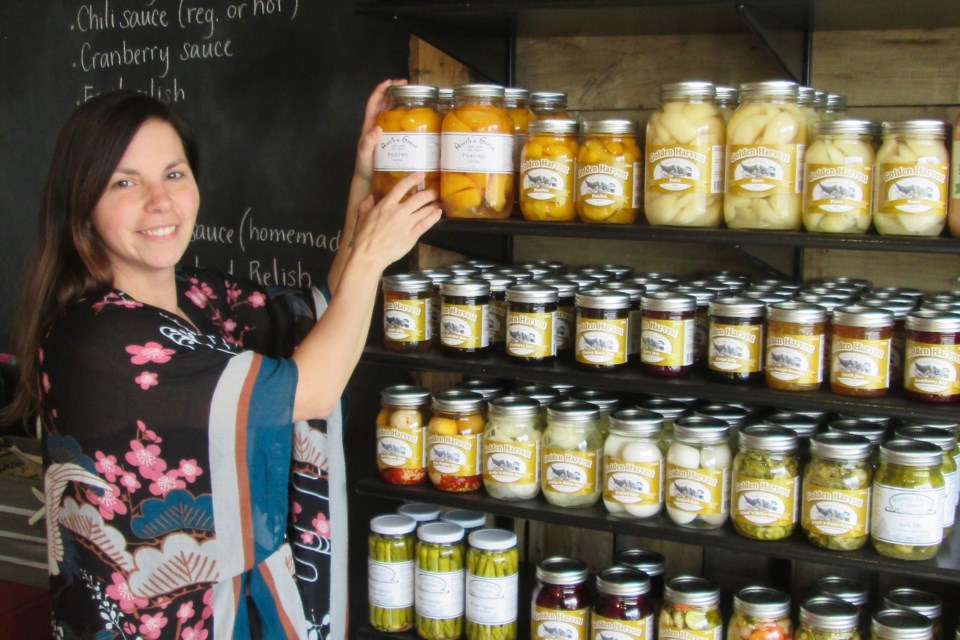Becky Lefebvre, owner of The Urban Farm in South Porcupine, displays some of the preserves offered at the store. The Urban Farm sells farm fresh food, including locally produced vegetables, meat, eggs and baked goods. Wayne Snider for TimminsToday