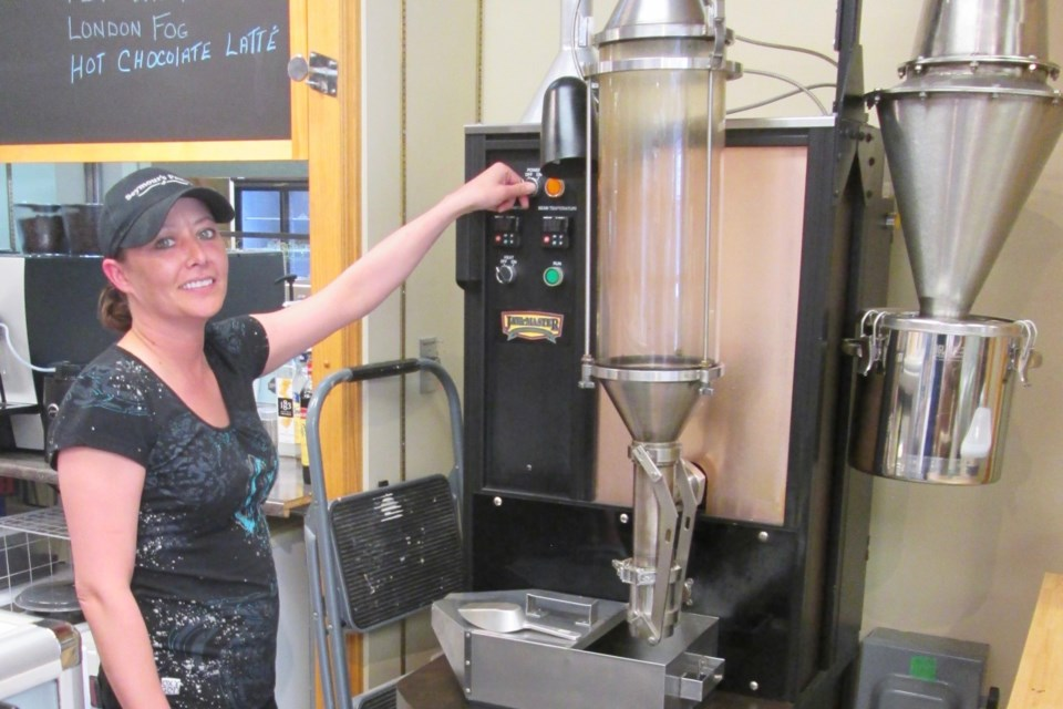 Seymour's Pantry in Downtown Timmins offers freshly roasted coffee beans. Here, staff member Lianne Savard displays the coffee roaster. It takes about 12 or 13 minutes to roast green coffee beans. Wayne Snider for TimminsToday