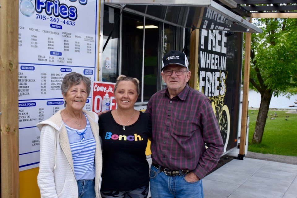 Fabi Allaire, left, Linda Walton, and James Allaire are ready to raise cash for Living Space at Bubbles Fries down at Gillies Lake. All the money made Thursday, June 27 at the chip stand in the parking lot is for the downtown facility. Maija Hoggett/TimminsToday