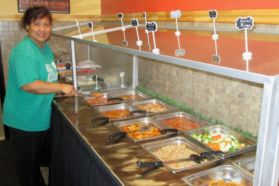 Estela Chow, owner of the Lady Luck Buffet and Restaurant, displays the buffet, which features a mix of Filipino and Canadian cuisine. Nothing goes to waste as at the end of the day leftovers are donated to the Living Space and the Good Samaritan Inn. Wayne Snider for TimminsToday