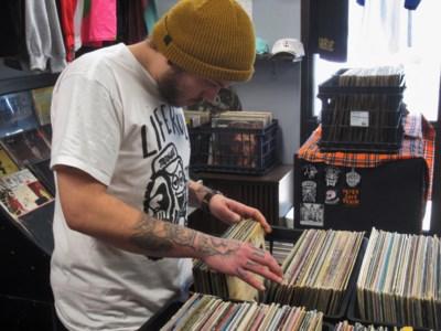 Lascelle flips through records