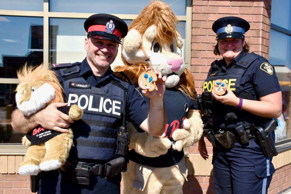 Timmins Police Const. Rick Lemieux, Daren, and OPP Const. Michelle Simard are excited for the launch of the Smile Cookie campaign, which is supporting DARE programming in Timmins. Maija Hoggett/TimminsToday