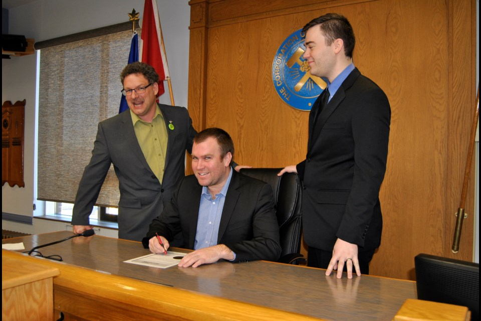 Mayor Steve Black (seated) proclaims March, 2017 to be Engineering Month in Timmins. With him are Tony Linton (left) Dumas Mining and Corey Goulet (right) Timmins Chapter Professional Engineers of Ontario. Frank Giorno for TimminsToday.