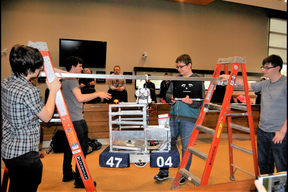 The robotics team from Timmins High demonstrates their climbing robot. From left to right Grant Wagoner, Jared Wagoner, Stan Street and Niko Loretto. Frank Giorno for TimminsToday.