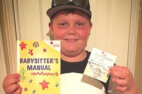 Brandon holding certificate