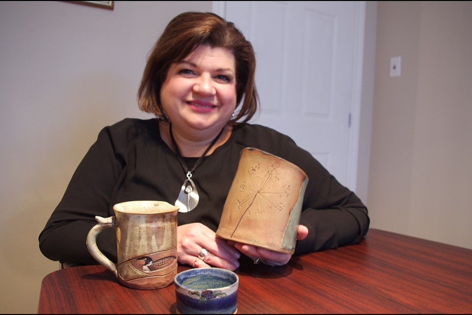 Chantal Yu with Otti Twardowski's pottery, which is being auctioned off Nov. 10 and 11 at the Senator Hotel in Timmins. Maija Hoggett/TimminsToday