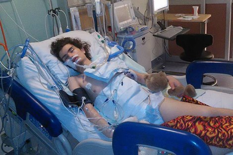 Alexander lies in his hospital bed at CHEO on Dec. 27 after his second surgery. Jessica Trudel for TimminsToday.