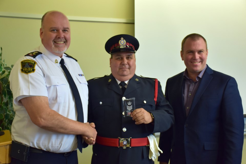 Timmins Police Chief John Gauthier, left, Glenn Simpson and Mayor Steve Black. Simpson was promoted to the rank of Timmins Police Service Auxiliary Staff Sergeant this week. Maija Hoggett/TimminsToday