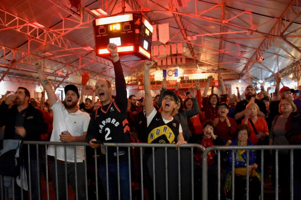 Fans celebrate the Raptors first NBA title at the Jurassic Park viewing party in Timmins. Maija Hoggett/TimminsToday